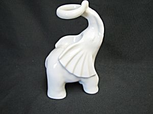 Fitz and Floyd Elephant Candle Holder--White ceramic with elephants truck up and in a circle to hold a candle--5 1/2 inches tall x 3 1/2 inches wide--Candle not included--Paper label says FF Japan and FF 1880 in black on the bottom