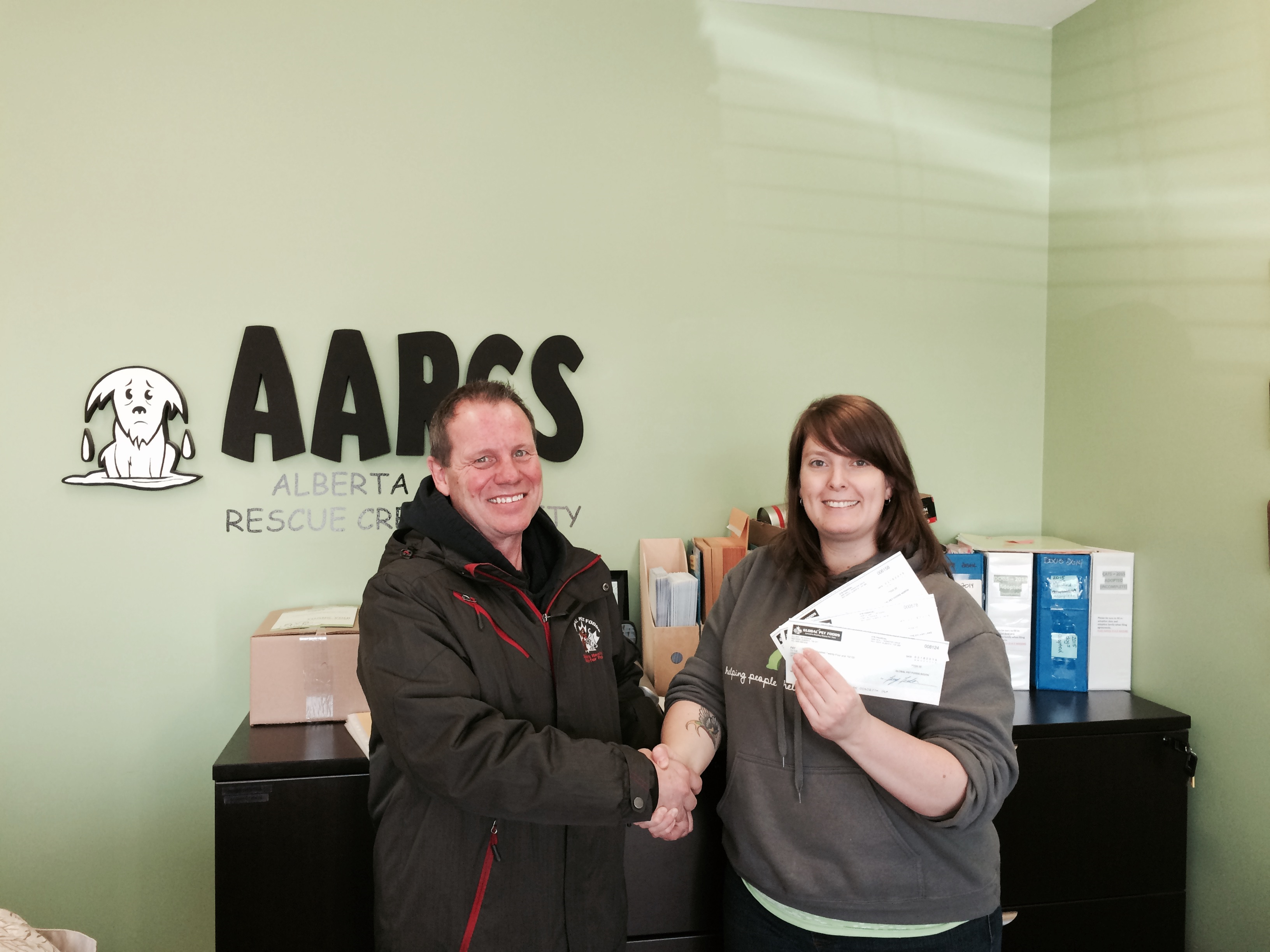 Pictured In This Photo Is Katie From The Alberta Animal Rescue Crew Society Larry Leeder The Owner Operator Of Th Animal Nutrition Healthy Pets
