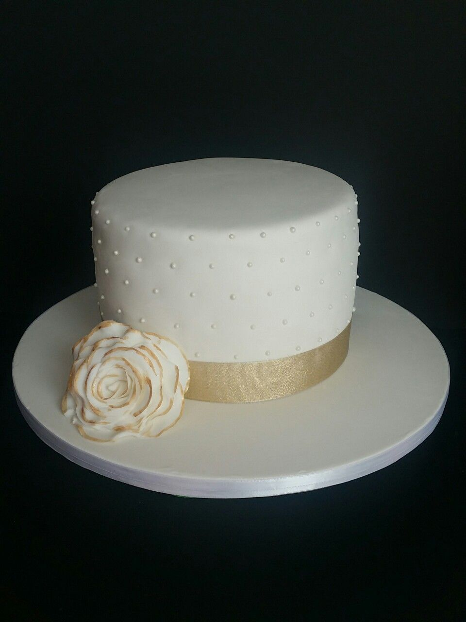Small gold and white wedding cake