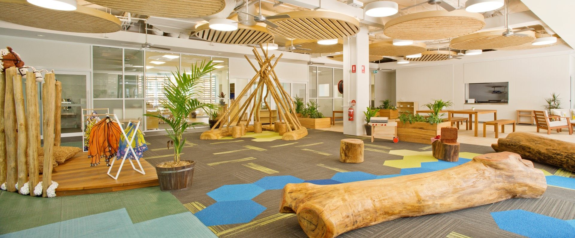 Indoor natural log playground goodstart child care for Indoor nature design challenge