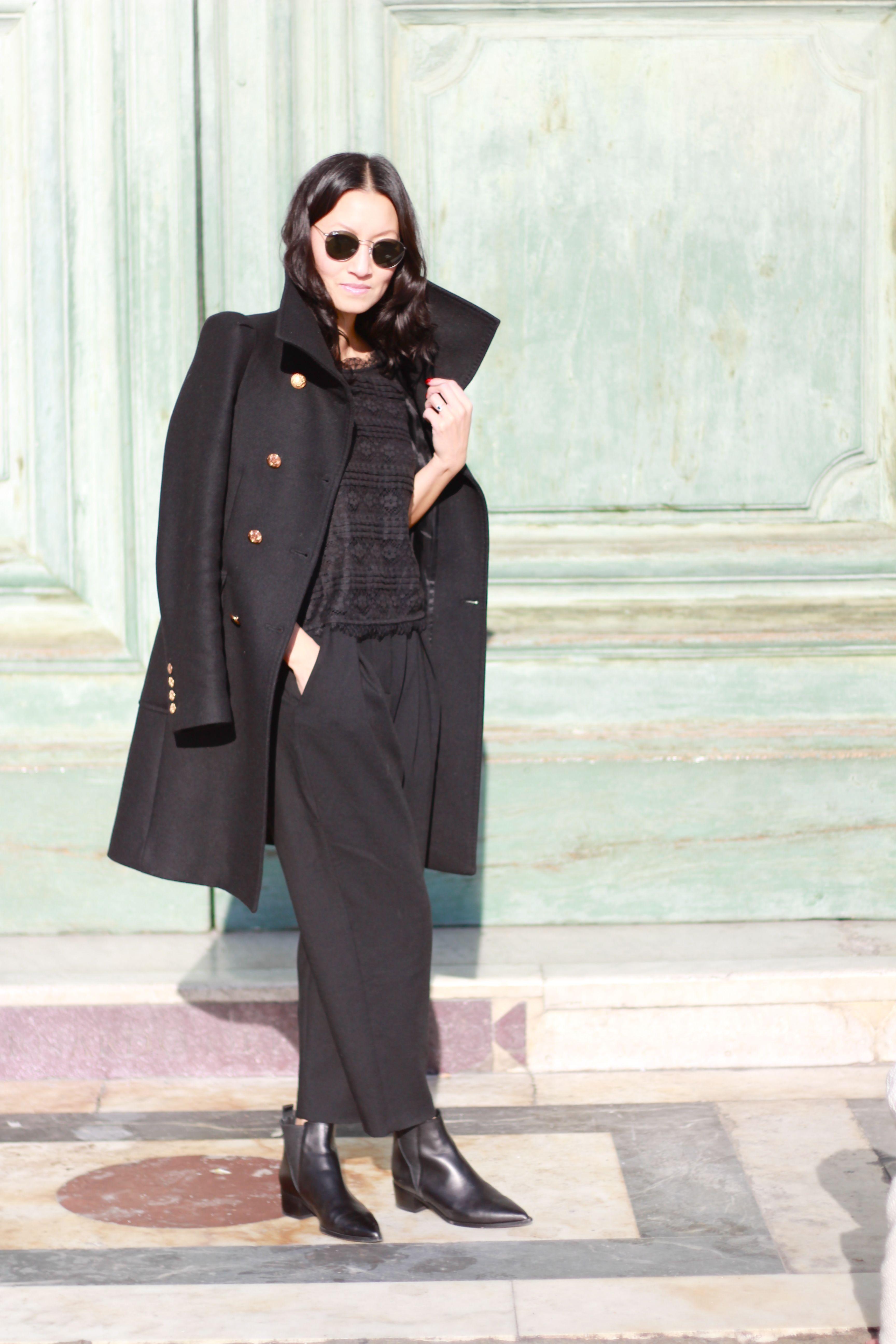 Women S Black Coat Black Lace Cropped Top Black Wide Leg Pants Black Leather Chelsea Boots Black Leather Chelsea Boots Black Wide Leg Pants Womens Black Coat