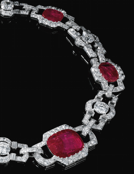 RUBY AND DIAMOND NECKLACE, 1930S Designed as a series of geometric links set with cushion-shaped rubies, circular-, single-cut and baguette diamonds, length approximately 345mm, separates into two bracelets, lengths approximately 175 and 170mm, each with French assay and maker's marks, one small diamond deficient.