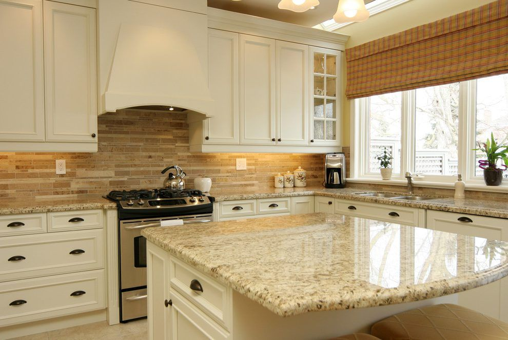 Backsplash with cream cabinets kitchen traditional with granite ...