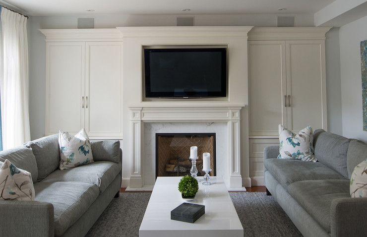 Beautiful Living Room With Creamy White Built In Cabinets On Either Side Of The Traditional