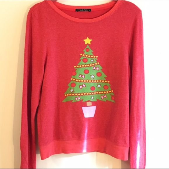 """WILDFOX Christmas Tree Jumper Brand New without Tags! Never worn! Perfect Condition! Always authentic.  I consider all offers, but use the """"make an offer"""" button.  If I accept it I'll let you know in a comment and then change the price for discount shipping.  ***will consider trading only for other WILDFOX holiday style items*** Wildfox Tops"""