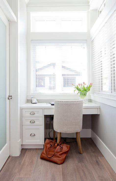 A Frosted Glass Pantry Door Opens To A Small White And
