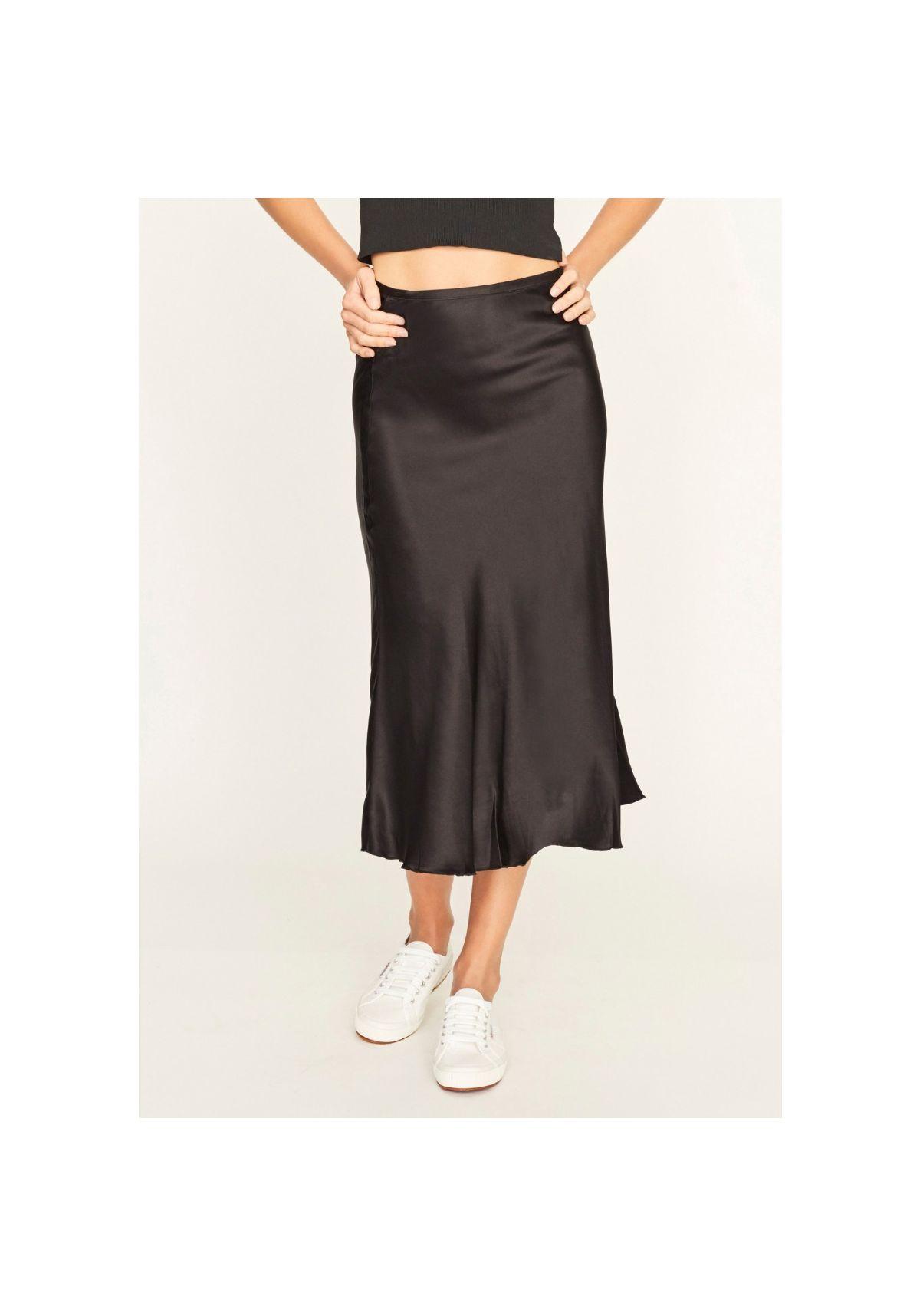 c4081c5f176e The Ellie Midi Skirt by Chosen in Black is a silk midi skirt with fluid hem