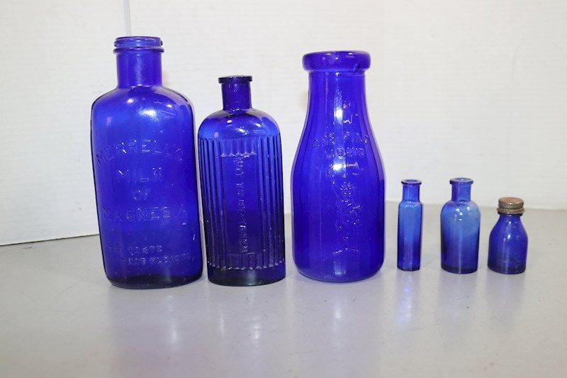 Blue Glass Bottles Merrell's Milk Of Magnesia/Milk - shopgoodwill.com