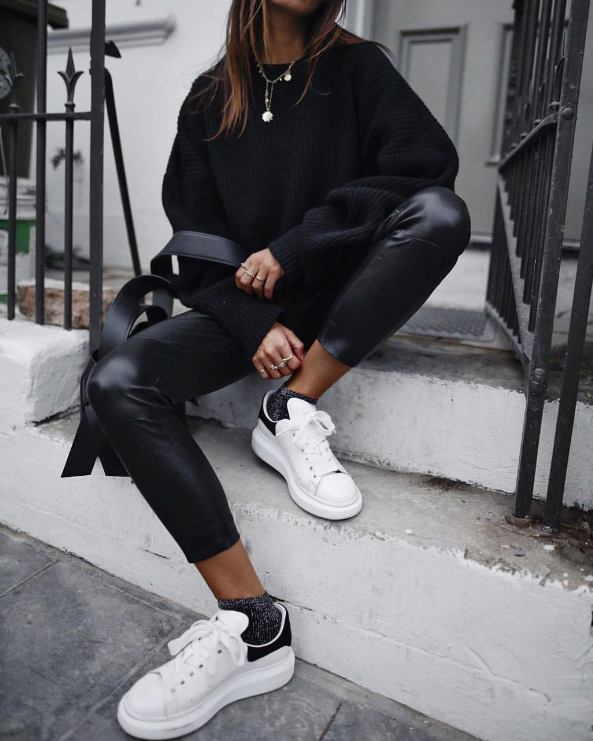 Trendy black leather pants with comfy oversized sweater and white sneakers. #leatherpantsoutfit