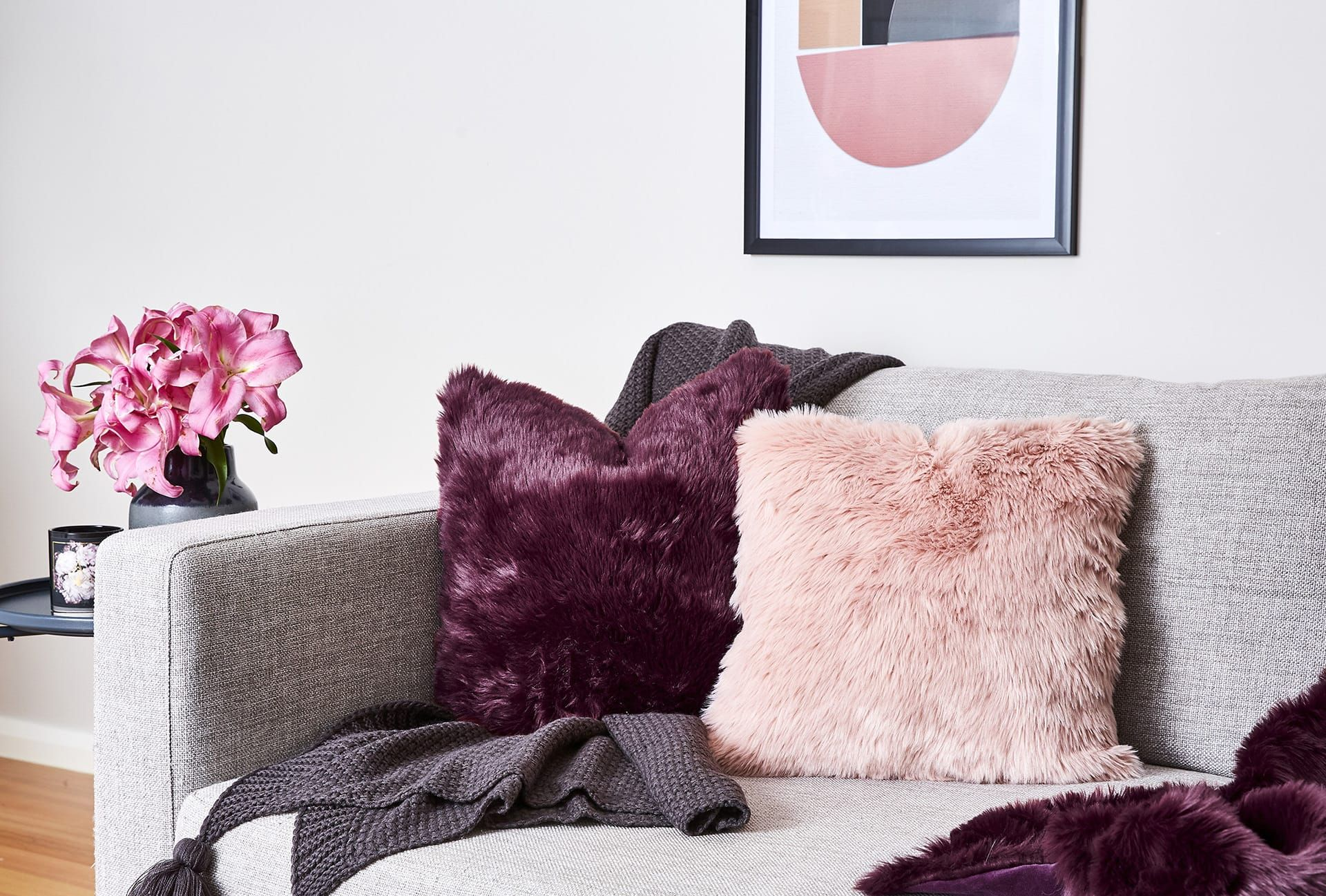 Blush And Purple Faux Fur Cushions On Grey Sofa Tlc Interiors Gray Sofa Purple Living Room Purple Bedroom