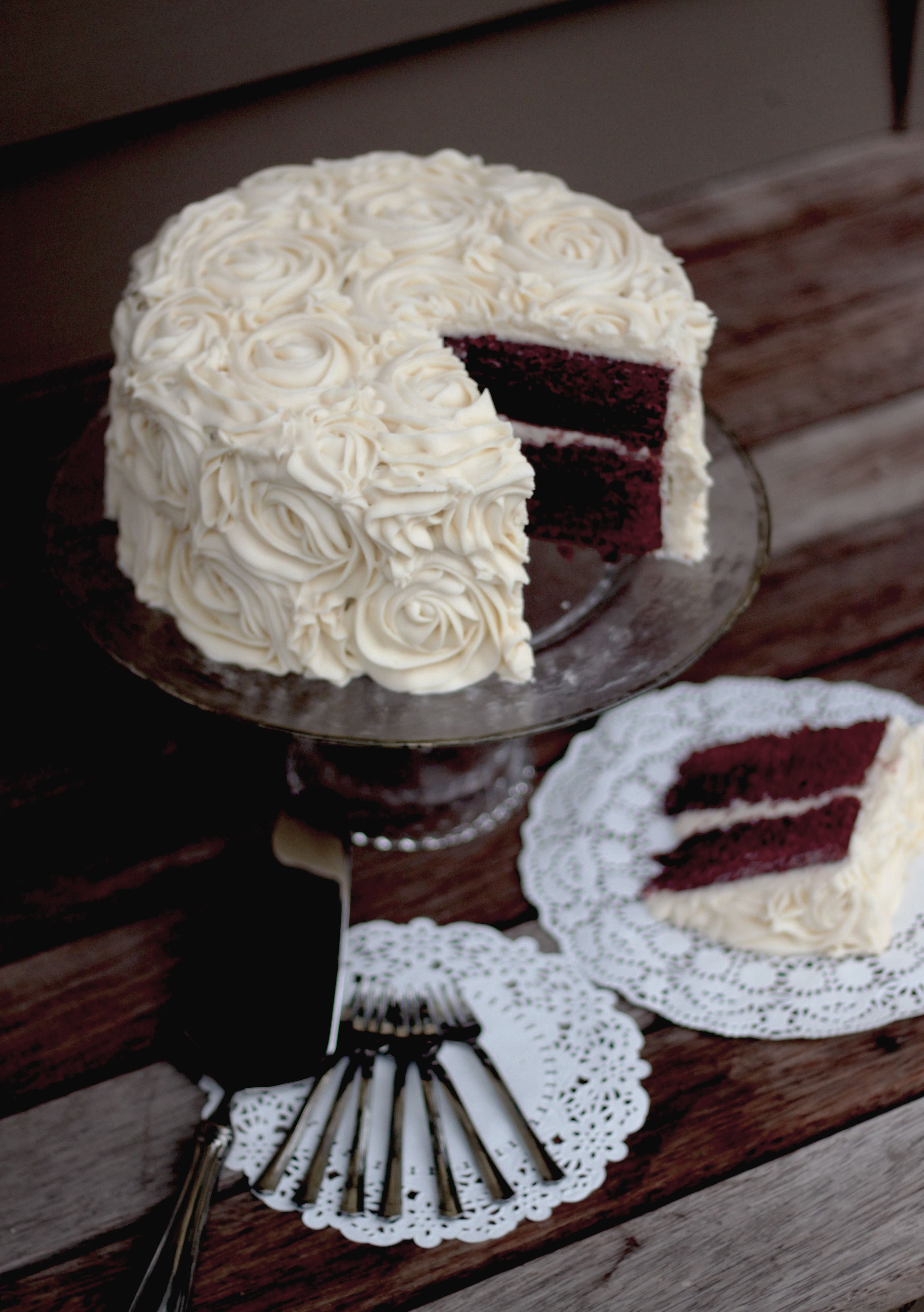 Red velvet cake with rose piped cream cheese frosting Birthday