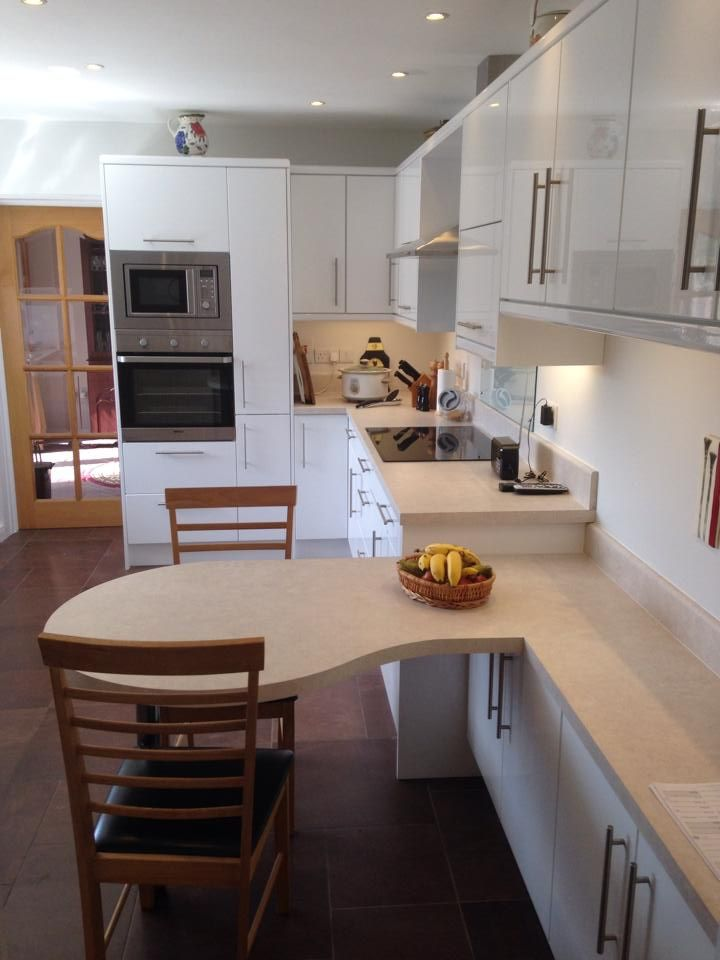 Dulleek Gloss White Kitchen With A Light Laminate Worktop Shaped Breakfast Bar By Kitchens Direct