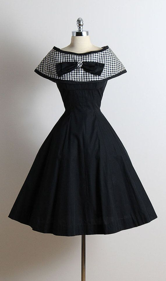47a6c0317e13 vintage 1950s dress * black cotton * detachable gingham print cape * bow  accent * full skirt * metal back zipper condition | excellent