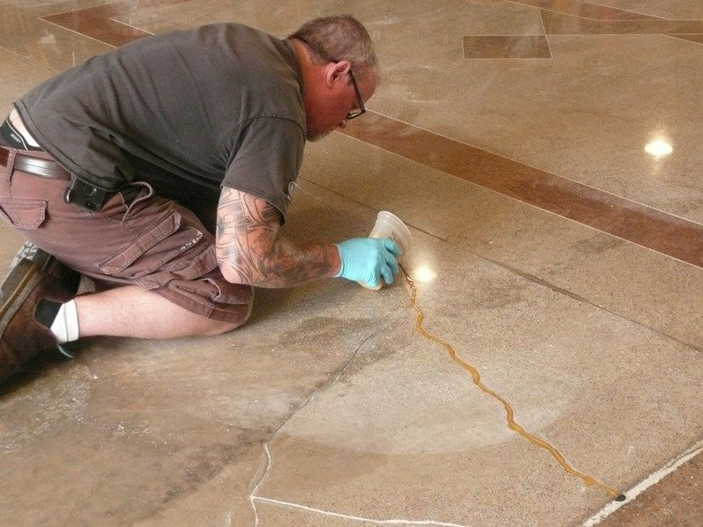 Filling cracks metallic epoxy site decorative concrete How to fill a crack in the wall