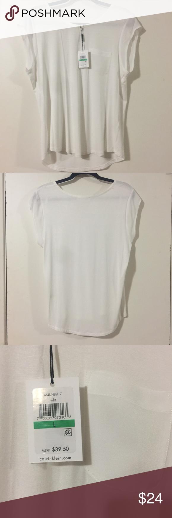 NWT - White Calvin Klein Top (L) Super soft NWT Calvin Klein top with pocket.  A closet staple for your spring wardrobe!!! Calvin Klein Tops Tees - Short Sleeve