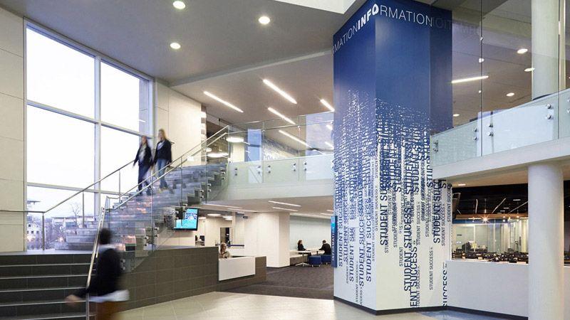 college dorms high school signage forward entry lobby interior design