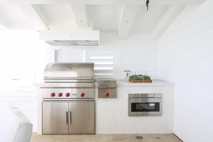 Outdoor Covered Patio Kitchen Features A Plank Ceiling Over White Shiplap Clad Walls Lined With A Wolf Bbq Outdoor Kitchen Design Patio Kitchen Outdoor Kitchen