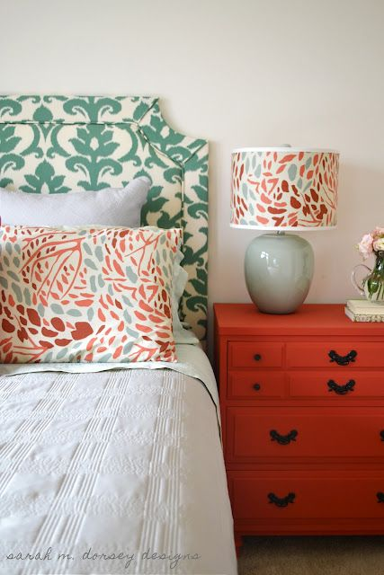 love the turquoise floral headboard and coral nightstands