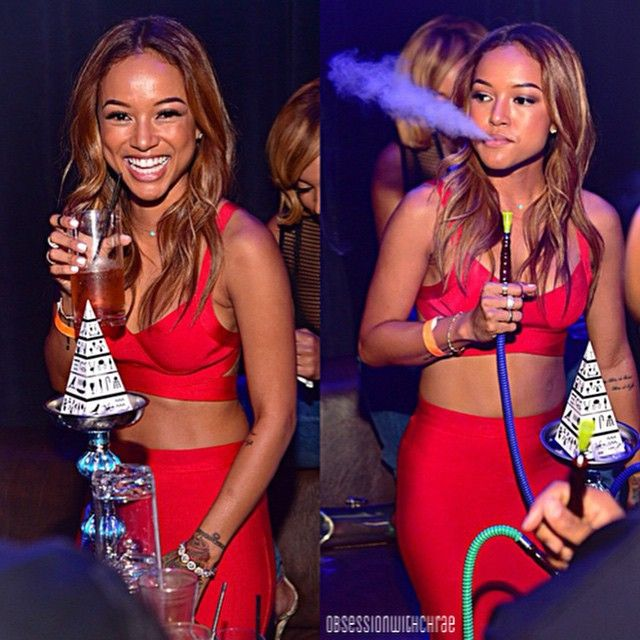 Karrueche Tran smoking a cigarette (or weed)