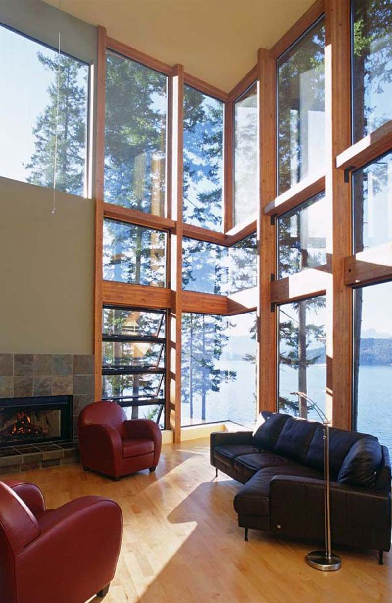 love double height windows but not those couches  COTTAGES ARE WHAT