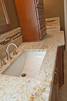 Art Exhibition Colonial Gold Bathroom Vanity Top on Cherry Cabinets