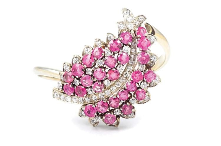 """Art Deco 14K pink sapphire diamond brooch, can be converted into a bangle. 27 pink sapphires weigh approximately 5.75 carat, old European and old mine cut diamonds weigh approximately 1.9 carats. Bangle is stamped EF (maker's mark) 580, brooch stamp F (with E on the border) 580 and a gold stamp. Brooch measures 1 3/4"""" long, 1 1/4"""" wide. Bangle can be stretched, weight 35.55g in total."""