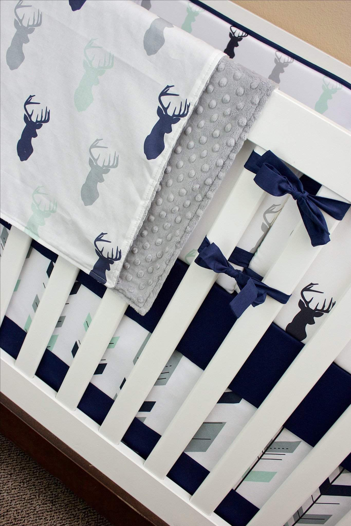 We Are So In Love With This Deer Crib Bedding For Your Forest Themed Nursery How Adorable Those Mint Navy And Gray Buck Heads Feather Arrows