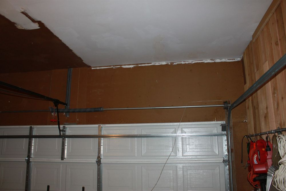 Shelves Over The Garage Door Garage Doors Garage Door Design Garage Door Opener