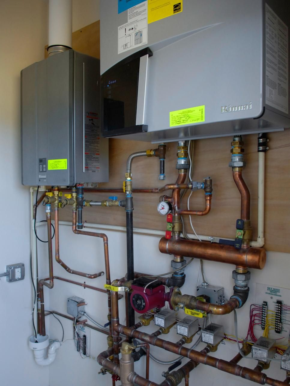 A State Of The Art Rinnai Tankless Water Heater And Boiler That Service Laundry Room Are Housed In An Adjacent Utility