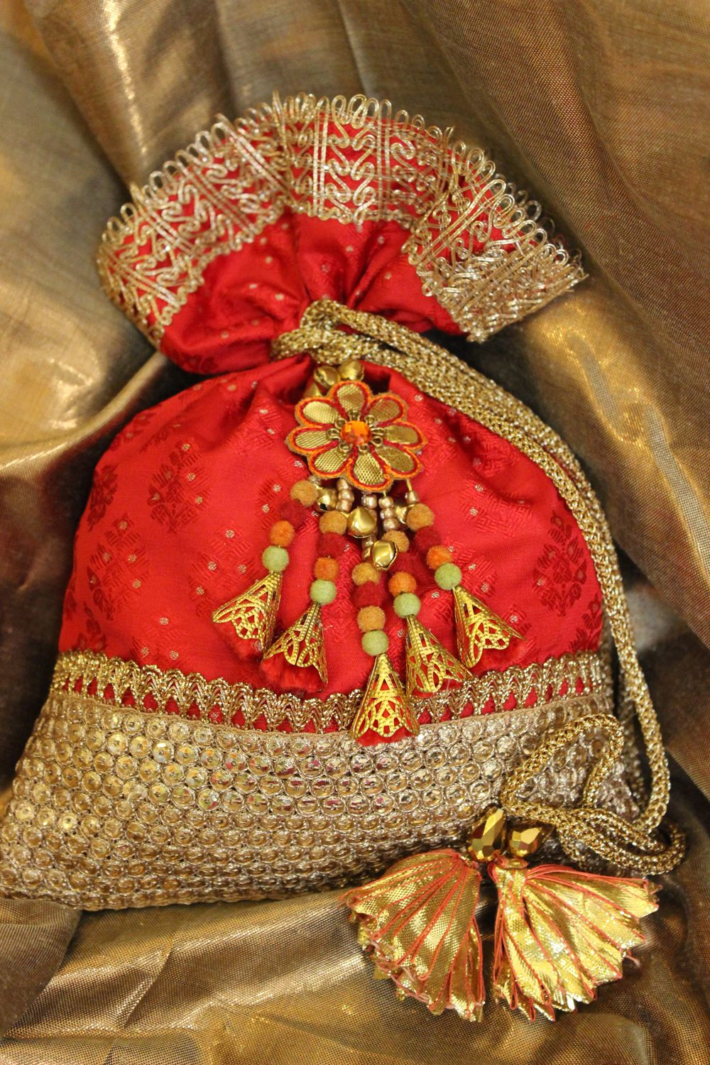 This Festive Season Try Carrying Ethnic Red And Gold Brocade Potli