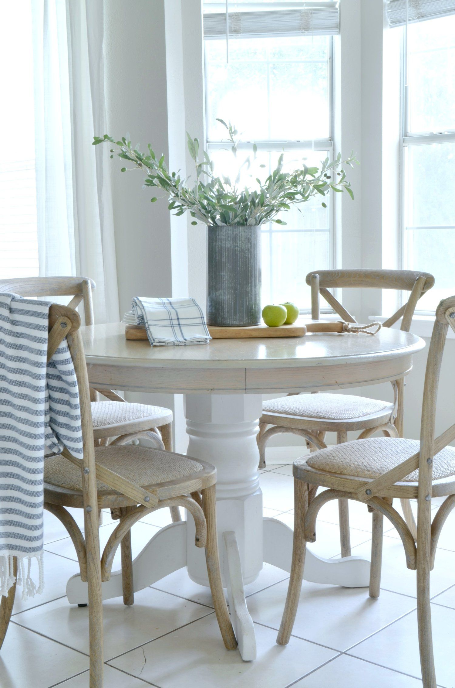 Farmhousestyle dining chairs give the breakfast nook an