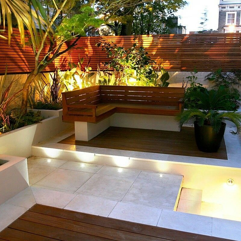 Small Garden Designs: Nice Fencing On Top Of The Low Wall. Cool Lighting Amongst