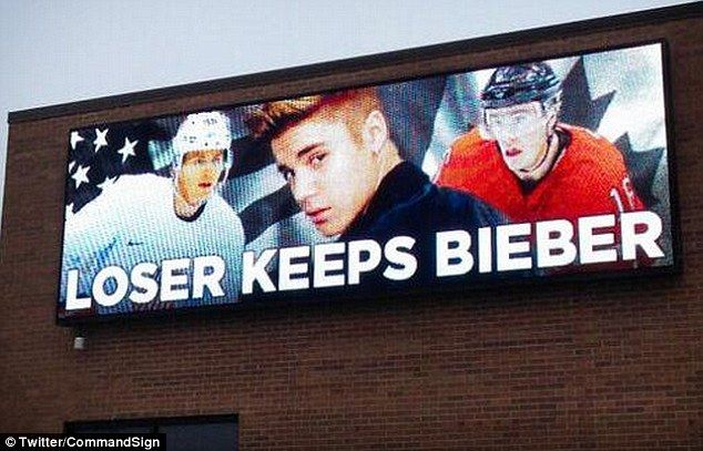 Wager: A billboard jokes that the loser of the USA's match with Canada 'keeps' Justin Bieber