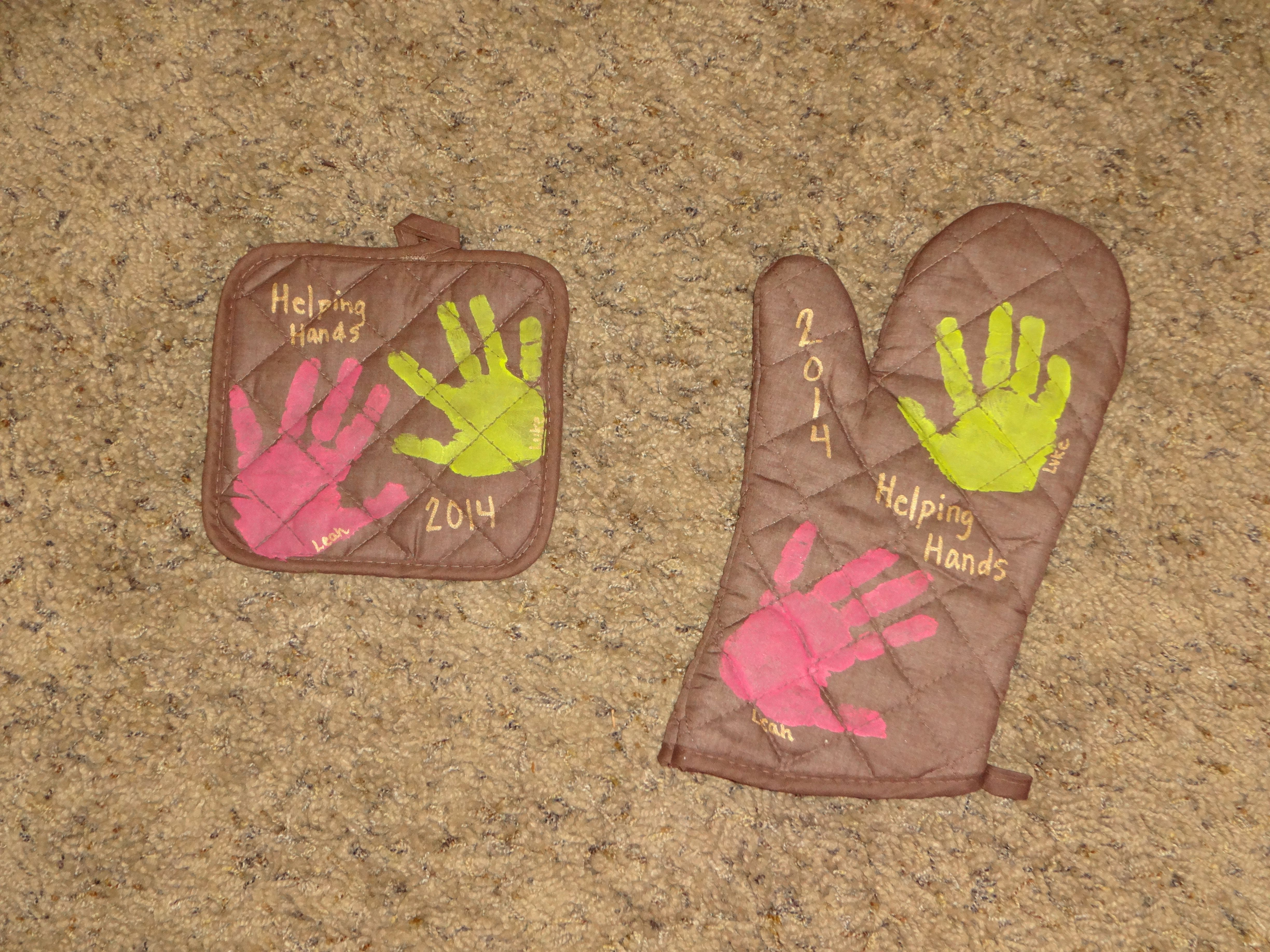Kids hand print oven mitt  We found the oven mitts at Dollar Tree