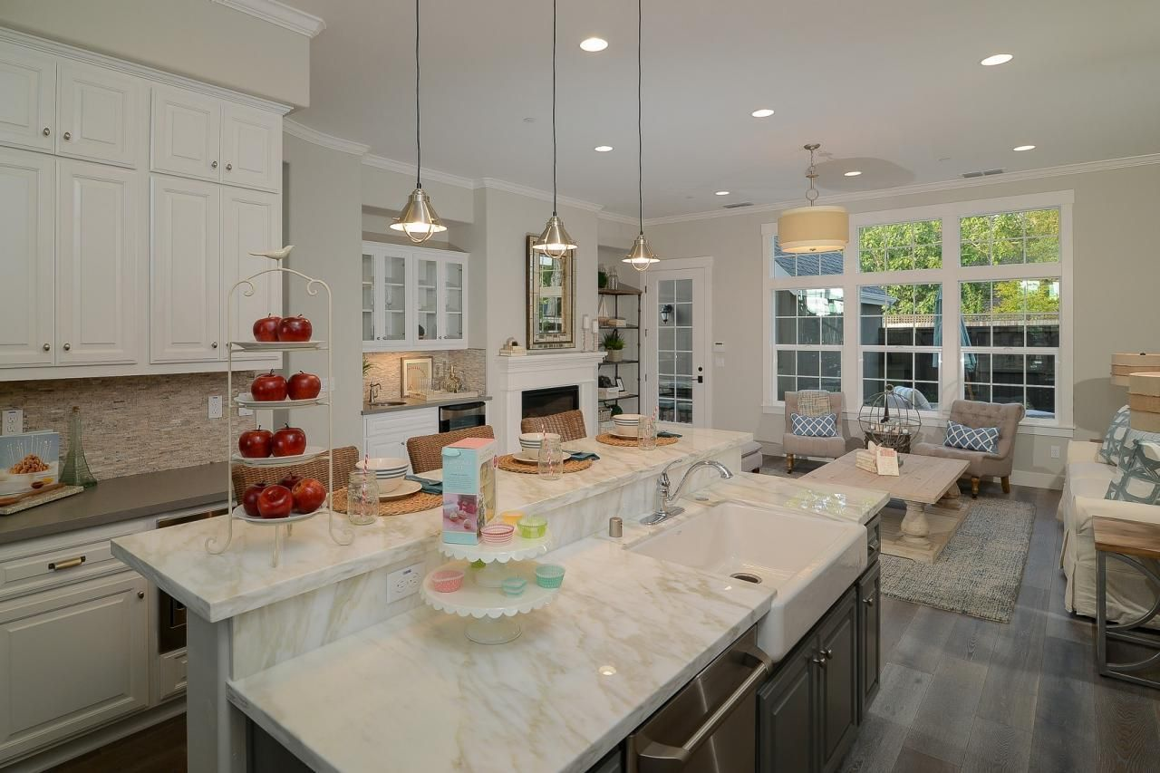 a two tier island creates extra prep and dining space in this gorgeous open concept kitchen on kitchen remodel with island open concept id=37062
