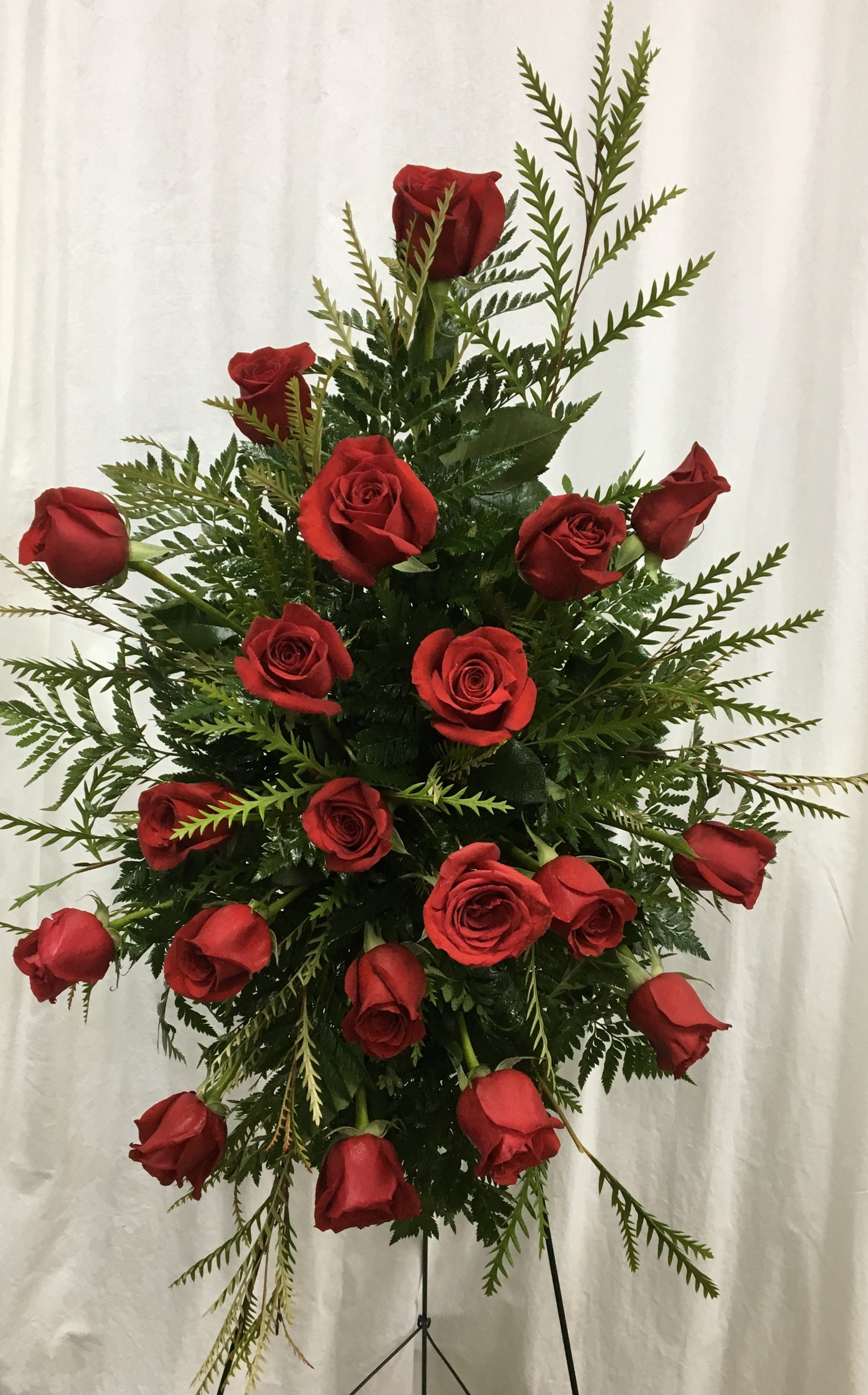 Red standard roses with sword fern and leather fern designed in an red standard roses with sword fern and leather fern designed in an easel cage on a izmirmasajfo