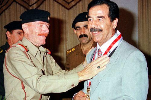 Walter WhiteIzzat Ibrahim al Douri photographed with Saddam Hussein, 1992.