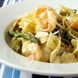 this recipe is a delicious option for shrimp. shrimp sauteed with asparagus and mushrooms, tossed with egg noodles.