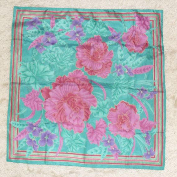 Vintage Thai silk multi-colored flower pattern scarf dating back to the 70s!    This exquisite silk scarf in luxurious green, gold and different shades of pink compliments any outfit.    Size: 90cmX90cm - 35.5''X35.5''    Perfect vintage condition!    BEFORE:20$  NOW:15$