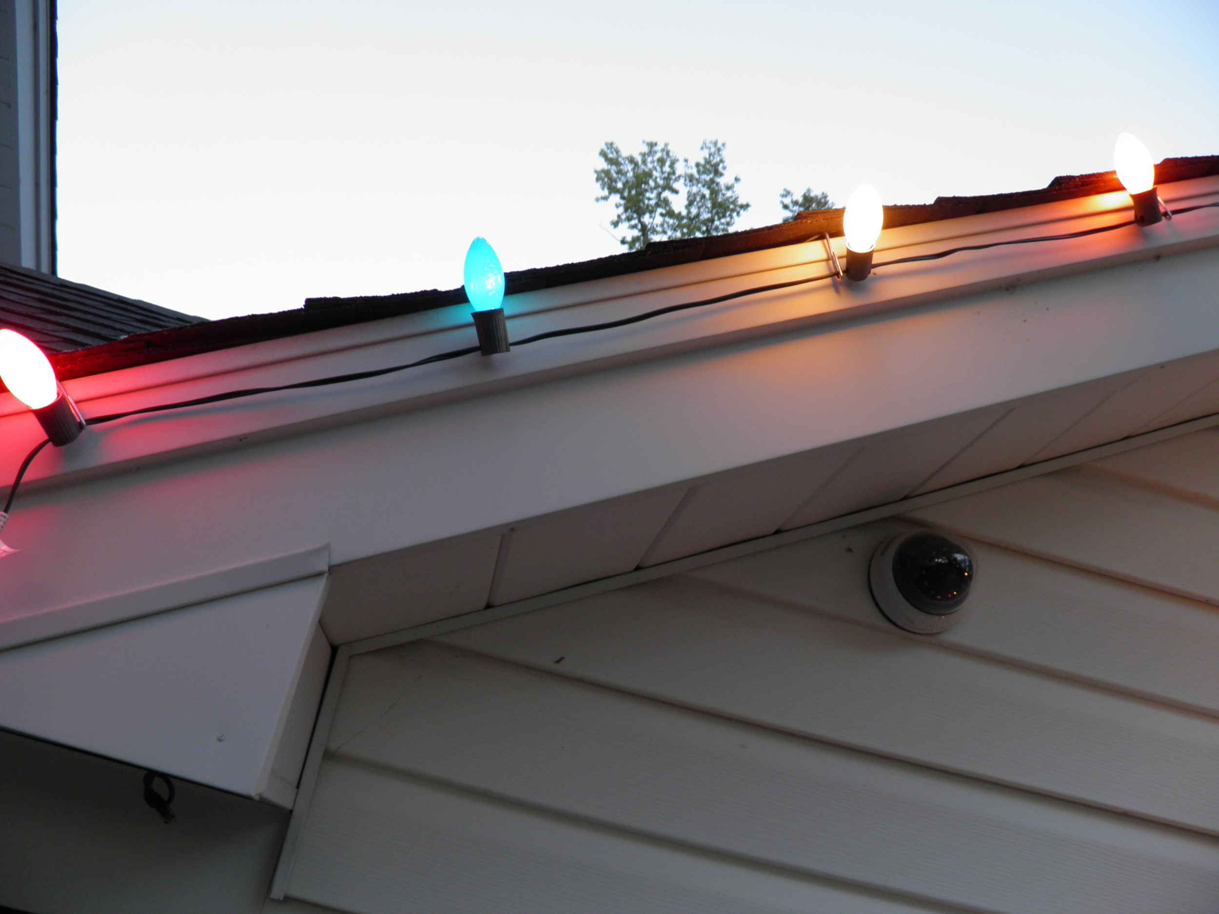 Using our new Christmas light hangers for shingled roof ...
