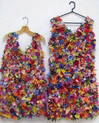 recycled costume by susan lenz: entirely made of cemetery flowers (collected from dumpsters, not from grave sites!). They were made on a water soluble stabilizer. Once stitched, the stabilizer was washed away….leaving just the flowers and the dress.