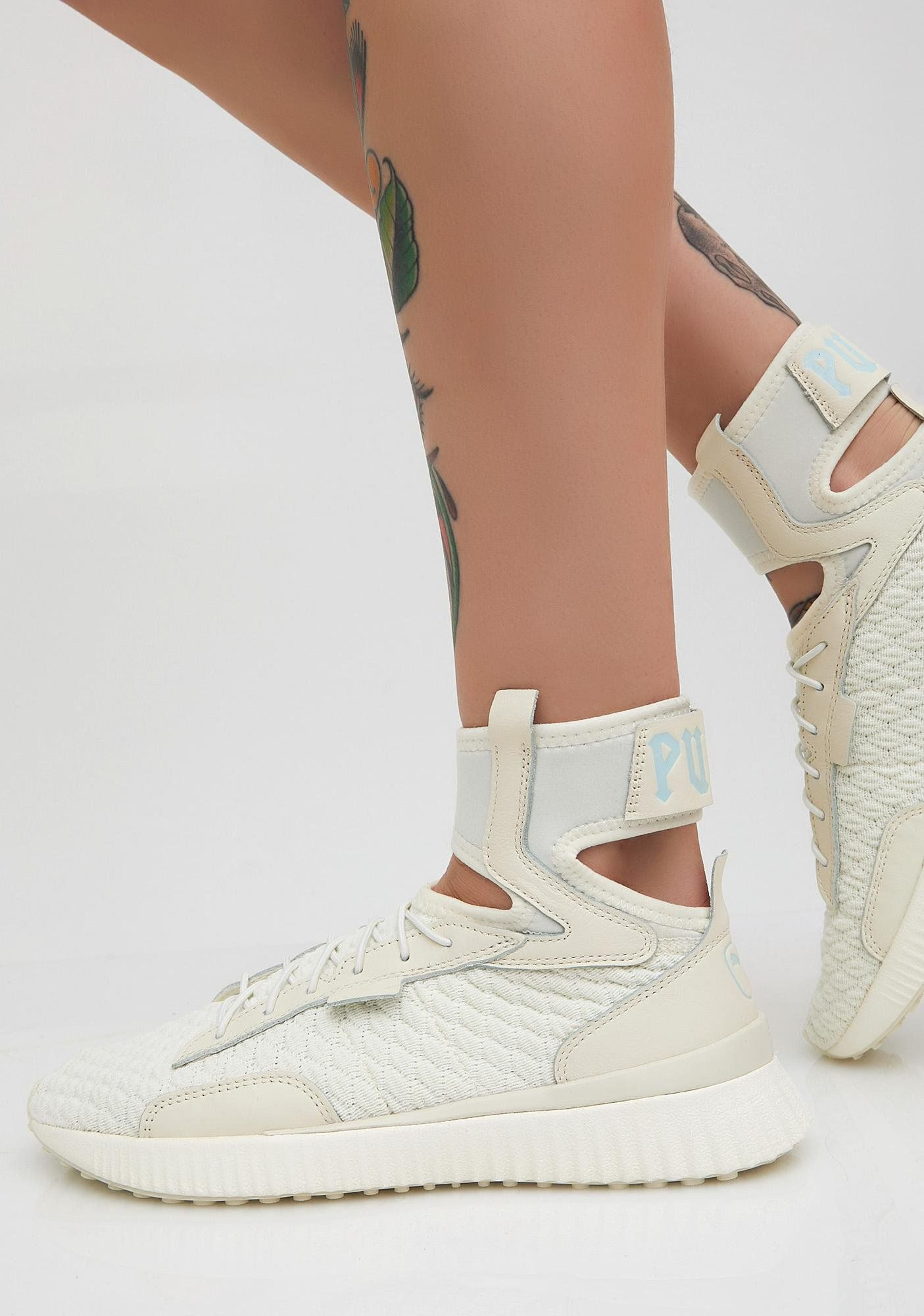 "PUMA FENTY PUMA By Rihanna Trainer Mid Geo Sneakers cuz you play the game  so good. These off-white sneakers have ankle straps with ""PUMA  text on the  back ... ba2feb2fd"