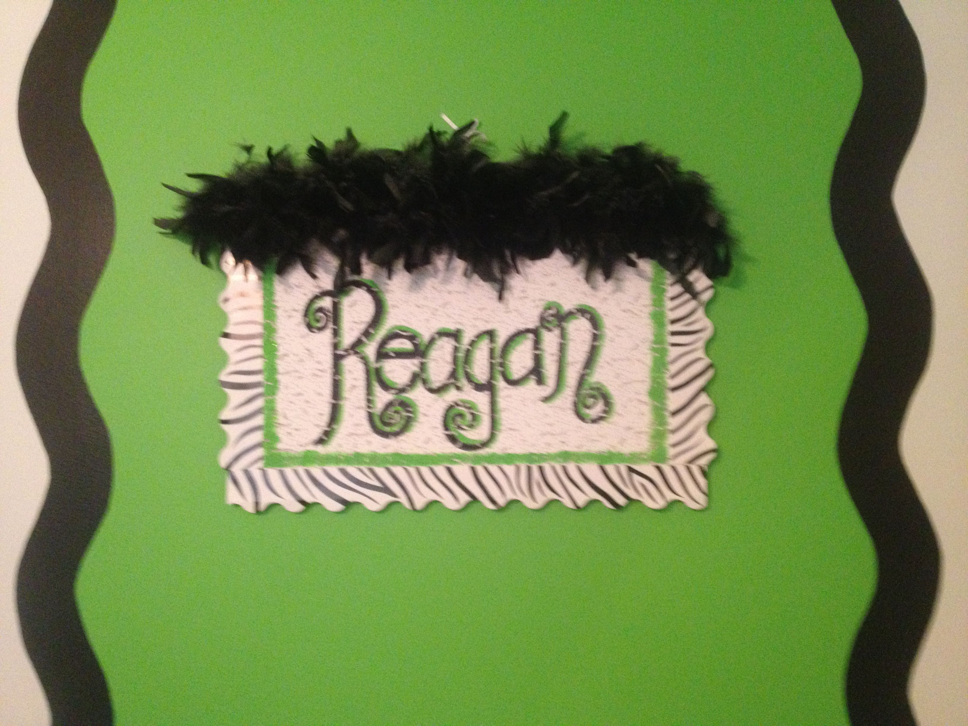 Take a ceiling tile and stencil or trace a name on it with paint. Add a border on the outside edges and glue a feather boa on the top. Easy and Cute for kids rooms :)