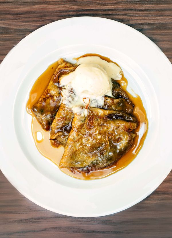 Crêpe suzette. Crêpe suzette is a classic French dessert combining thin pancakes with a boozy orange sauce.