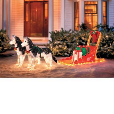 this unique christmas lawn decoration features two handsome huskies pulling a dog sled filled with gifts