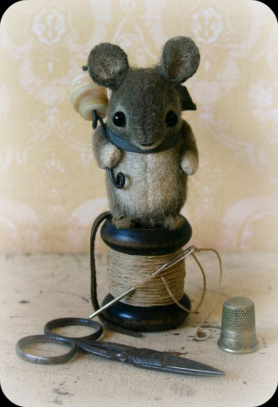Up for adoption today is a hand-painted wool felt mouse. He has black glass bead eyes, a suede tail and chenille stem feet. I have perched him on