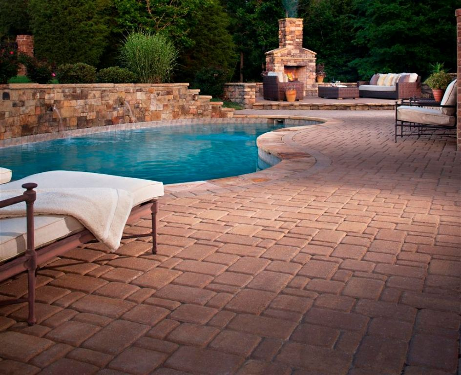 Mountain Lake Pool Idea With Stone Wall And Raised Patio Section