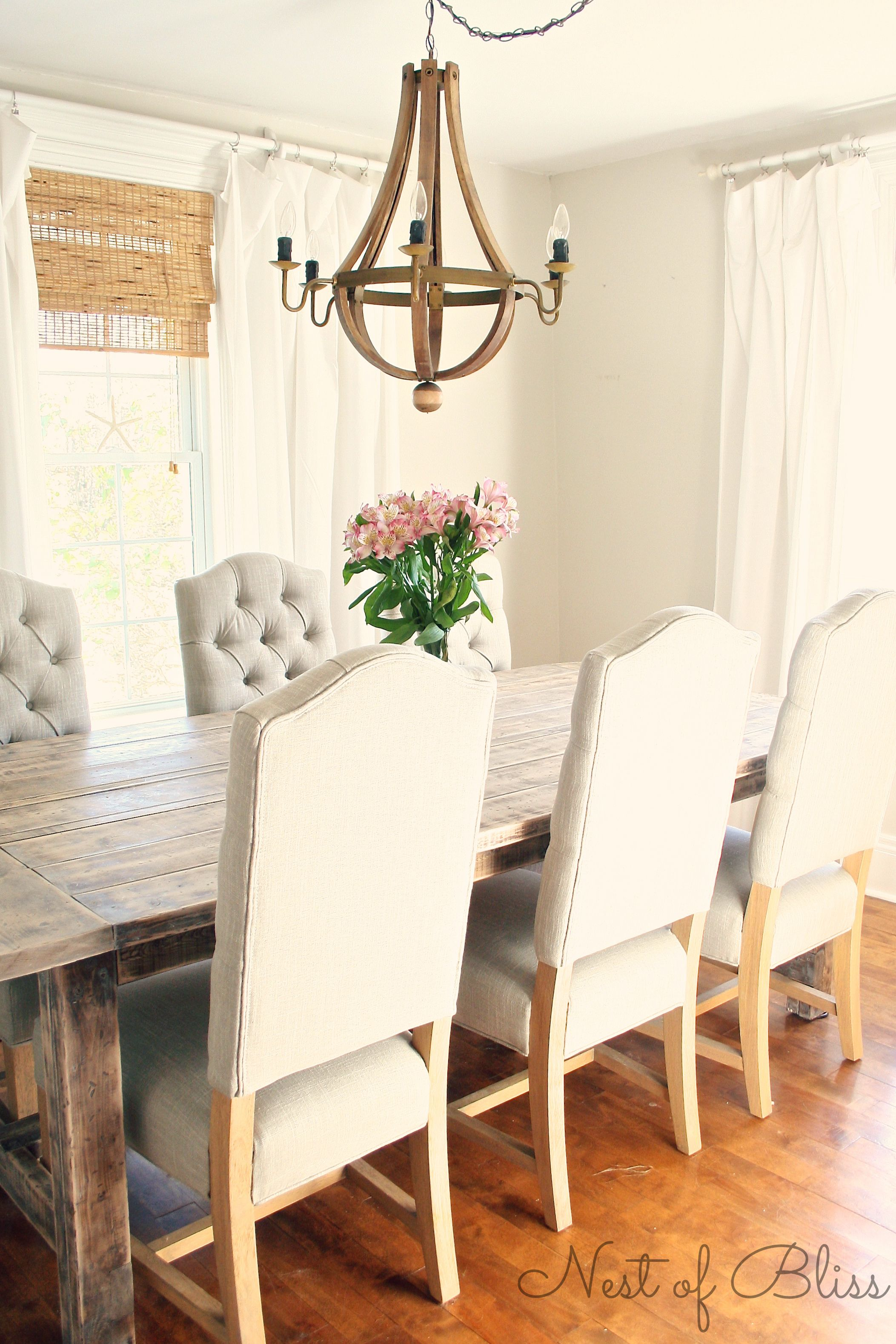 Wicker Emporium Dining Chairs Paired With A Rustic Farmhouse Table And Restoration Hardware Knock Off Chandelier