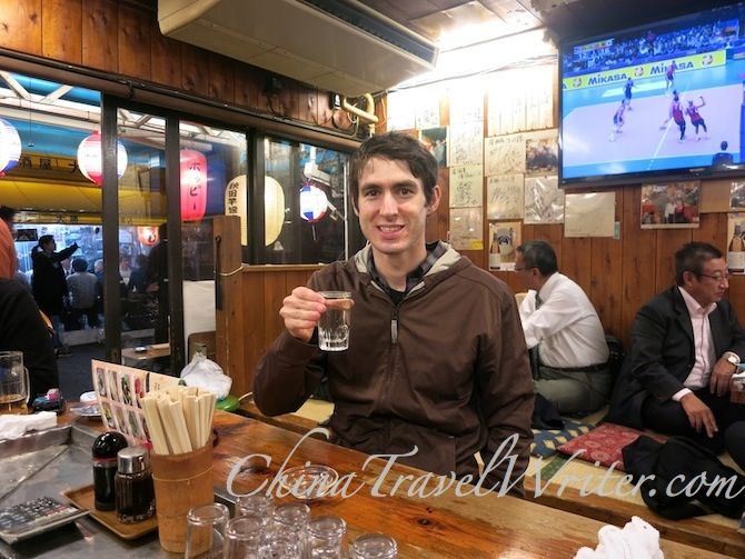 The China Travel Writer enjoys some sake at a traditional ...