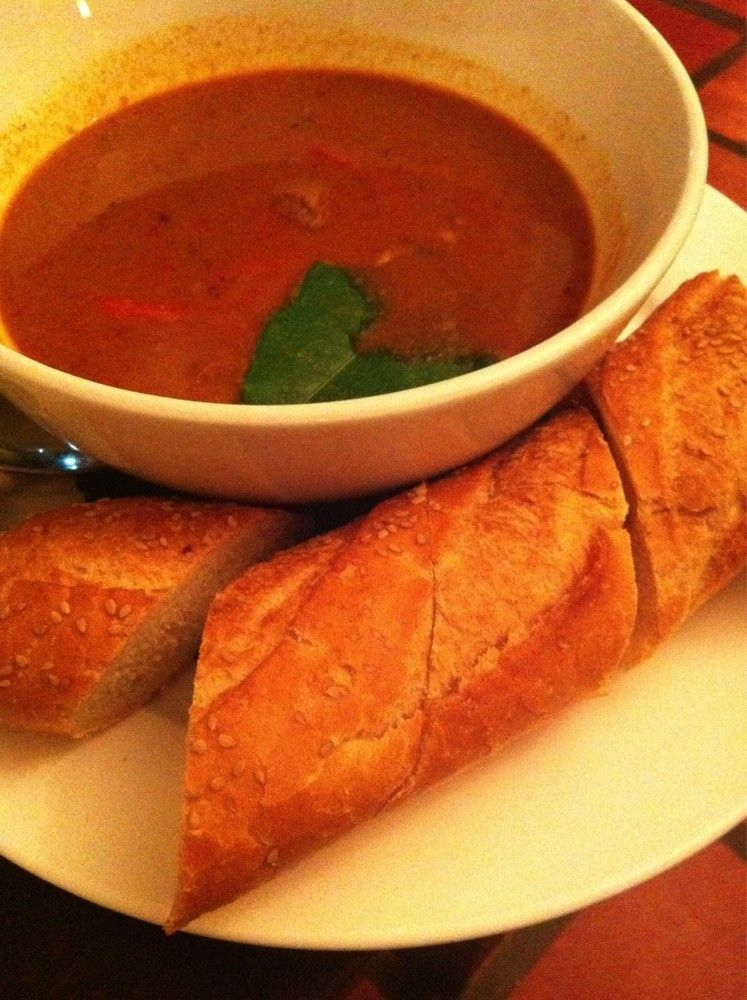 Muslim beef curry served with baguette